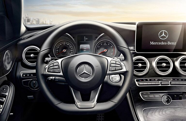 steering wheel and infotainment close-up on the 2017 Mercedes-Benz C-Class