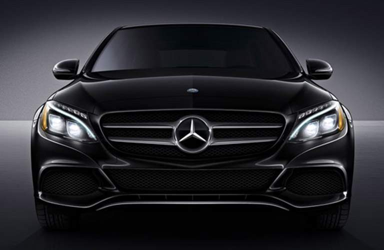 front view of a black 2018 Mercedes-Benz C-Class with bold lighting