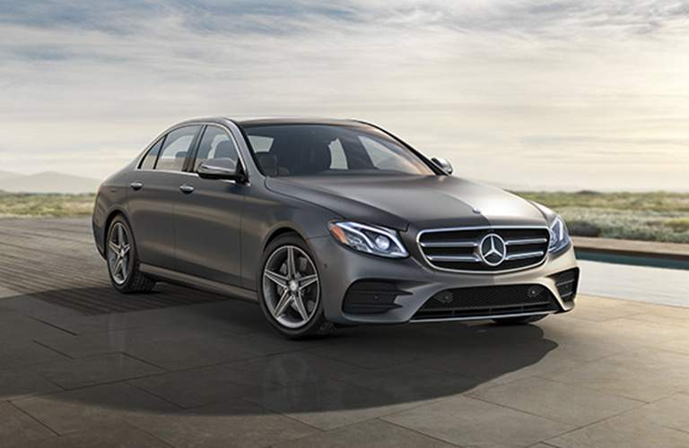 side and front view of the 2018 Mercedes-Benz E-Class Sedan on a sunny day