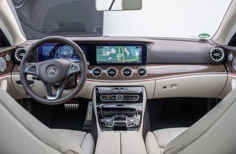 wide view of the dashboard of the 2018 Mercedes-Benz E-Class Coupe with two 12.3-inch display screens
