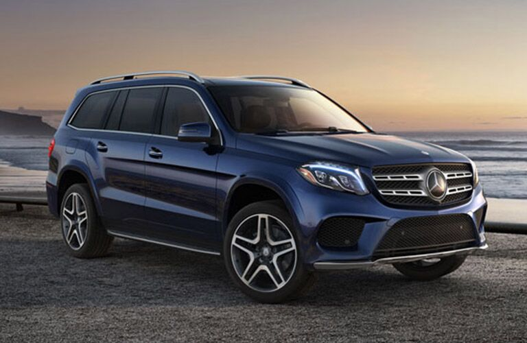 blue 2019 Mercedes-Benz GLS with three rows