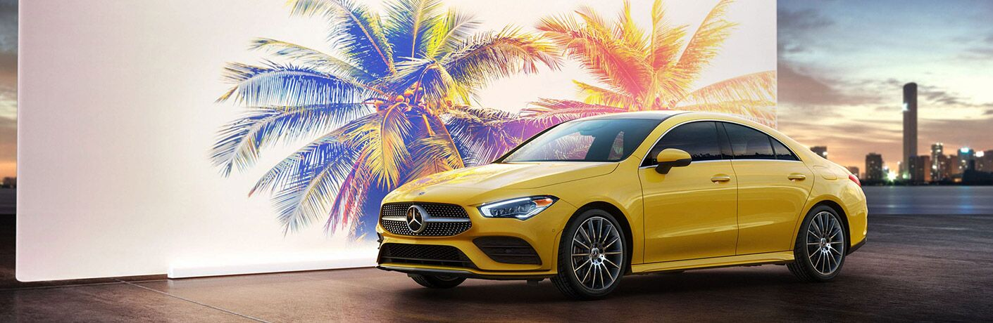 2020 MB CLA yellow driver side front fascia in front of mural of palm trees