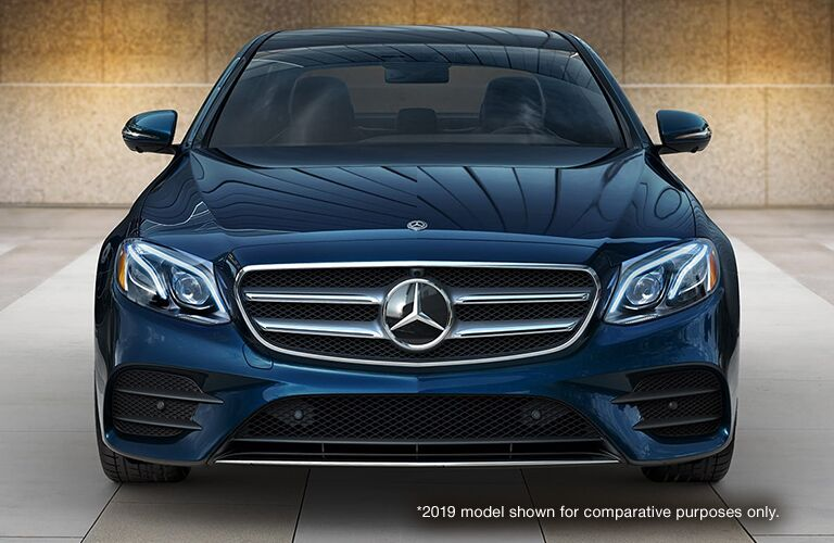 Blue 2019 Mercedes-Benz E-Class Front Exterior with White *2019 Model Shown for Comparative Purposes Only. Text in Lower Right