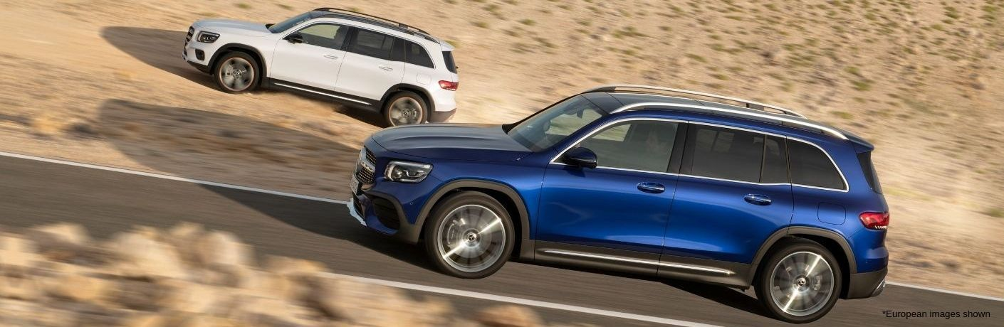 White 2020 Mercedes-Benz GLB and blue 2020 Mercedes-Benz GLB driving in desert