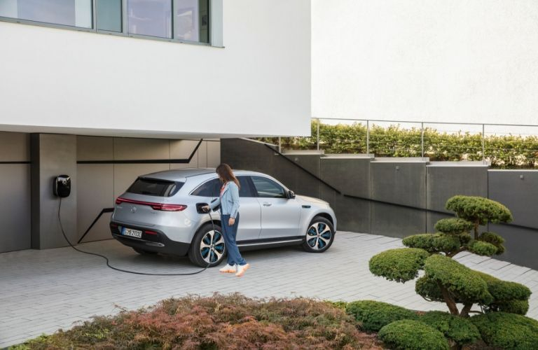 Woman charging 2020 Mercedes-Benz EQC