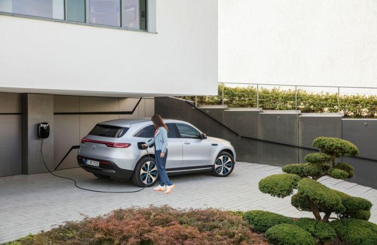 Woman charging 2020 Mercedes-Benz EQC