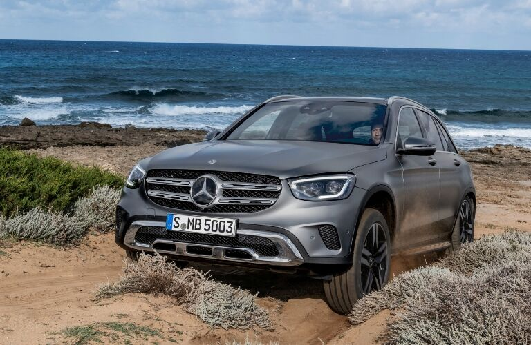 Grey 2020 Mercedes-Benz GLC SUV driving on beach