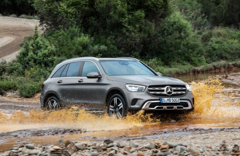 Grey 2020 Mercedes-Benz GLC SUV driving through muddy water