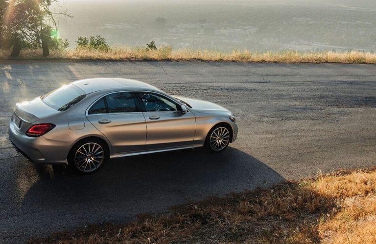 2020 Mercedes-Benz C-Class sedan driving down road from exterior passenger side
