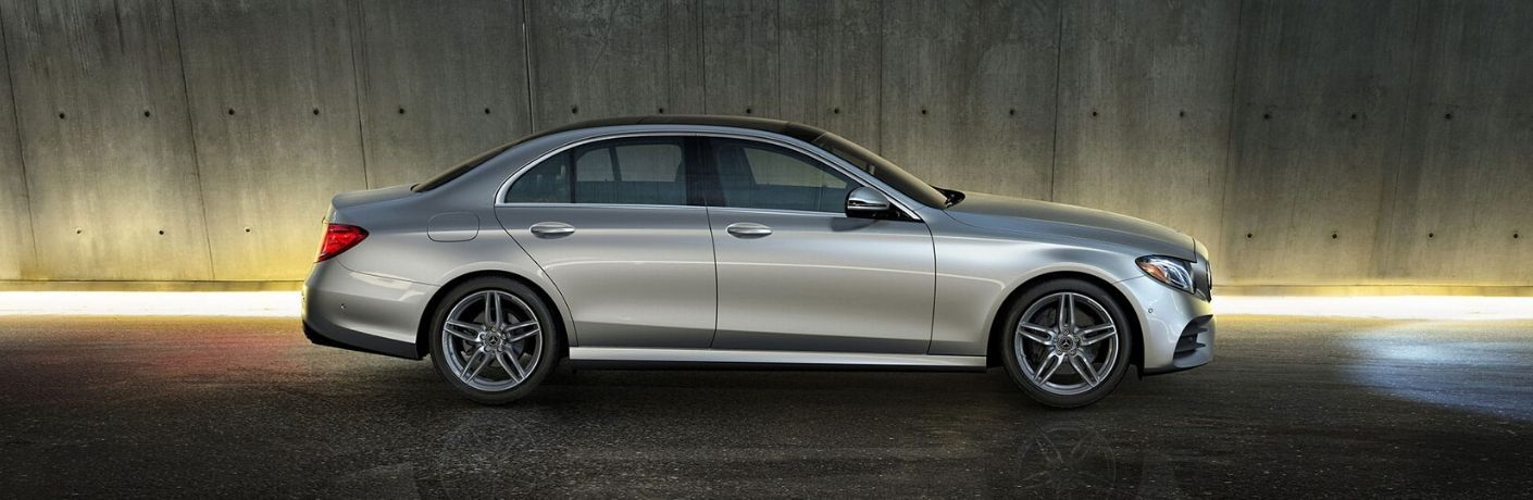 Silver 2020 Mercedes-Benz E-Class Side Exterior in a Garage