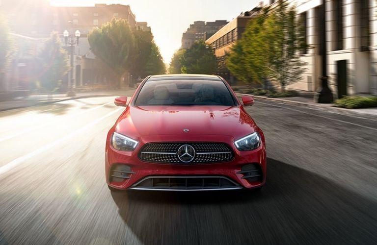 2021 Mercedes-Benz E-Class Designo Cardinal Red Metallic driving down a street