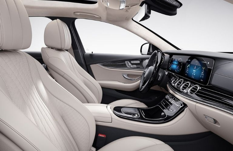 A close-up of the steering wheel, front seats, and dashboard in the 2021 Mercedes-Benz E-Class