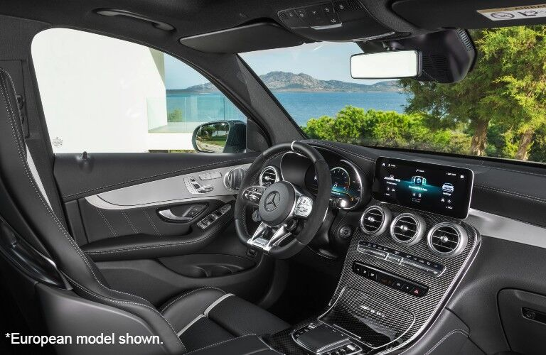 2022 Mercedes-AMG® GLC 63 S SUV interior front dash from passenger side European Model Shown