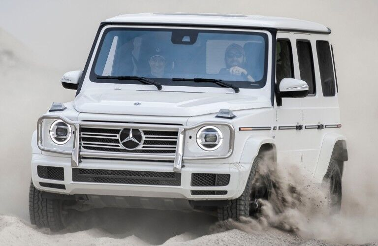 White 2021 Mercedes-Benz driving through sand