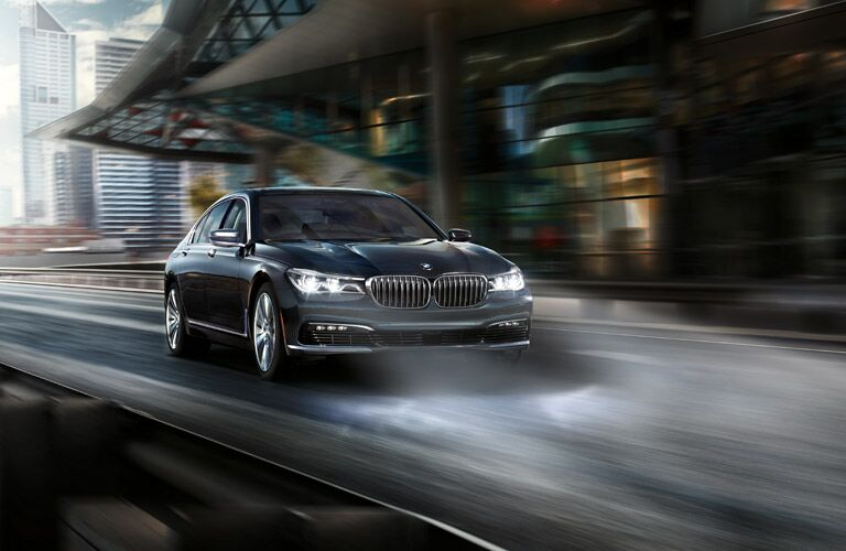 BMW 7 Series Exterior View with Headlights on Black Exterior