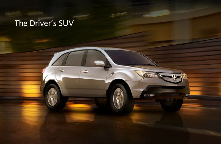 Silver exterior view Acura MDX SUV