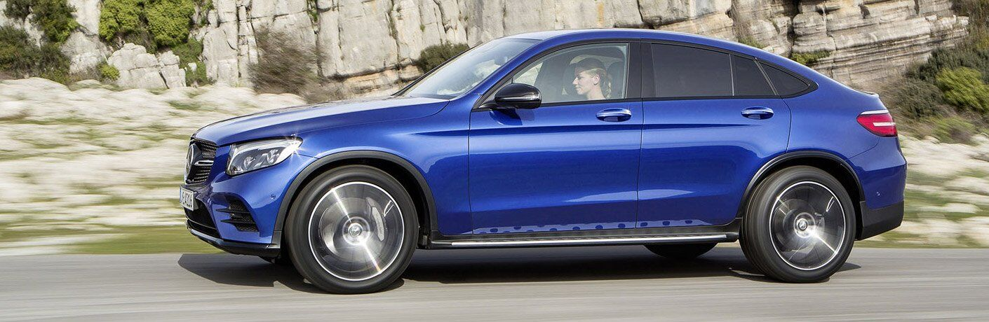 2018 Mercedes-Benz GLC Coupe driving by a mountain