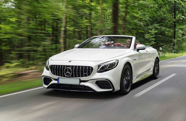 2018 Mercedes-Benz S-Class Cabriolet driving on road in forest.