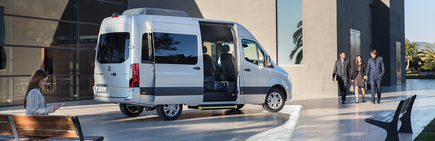 2018 Mercedes-Benz Sprinter with open doors, white exterior outside building with people walking by
