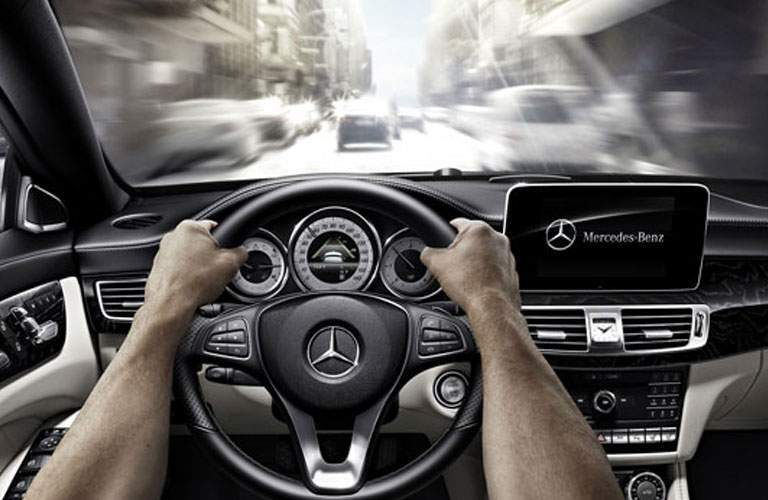 Hands gripping steering wheel of 2018 Mercedes-Benz CLA Coupe