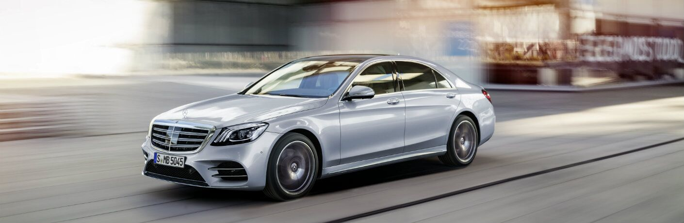 2018 Mercedes-Benz S-Class AMG S 63 gray exterior driving in the city