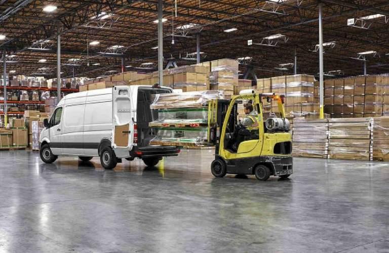 Forklift loading pallet into 2017 Mercedes-Benz Sprinter Cargo Van