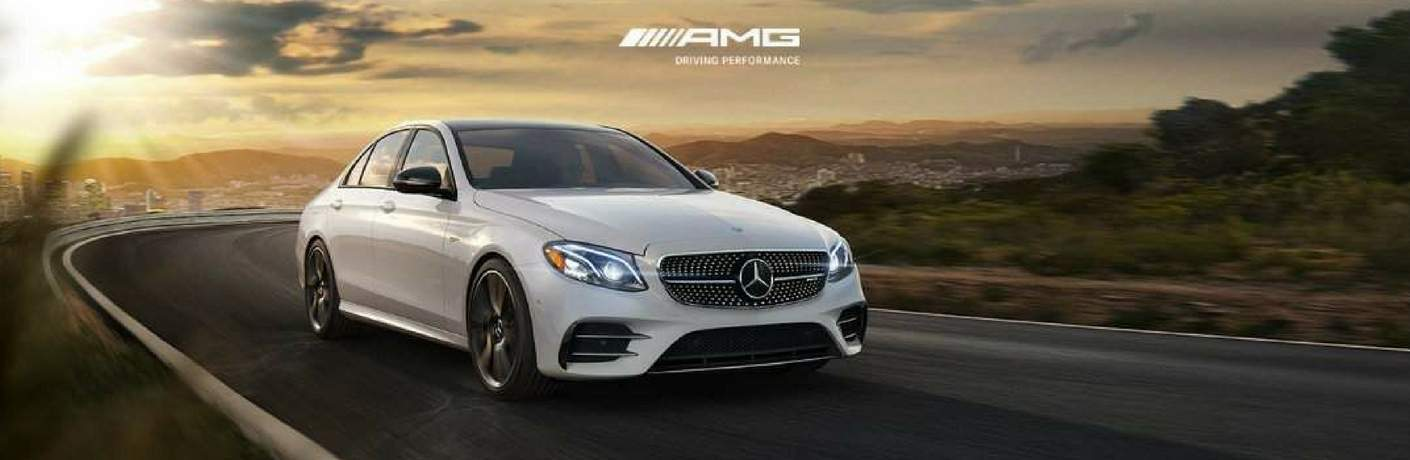 Mercedes-AMG vehicle driving down road