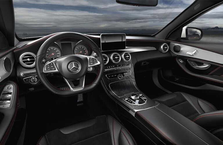 interior shot of the steering wheel and touch screen inside of the 2018 Mercedes-Benz C43