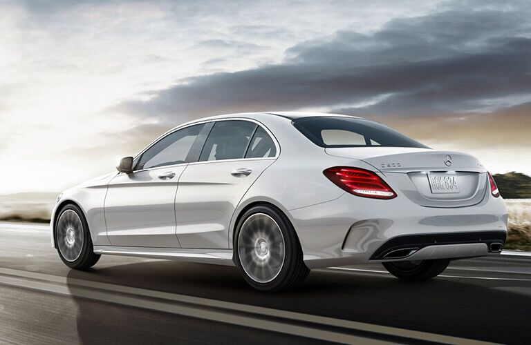 2018 Mercedes-Benz C-Class sedan driving on the road with a sunset