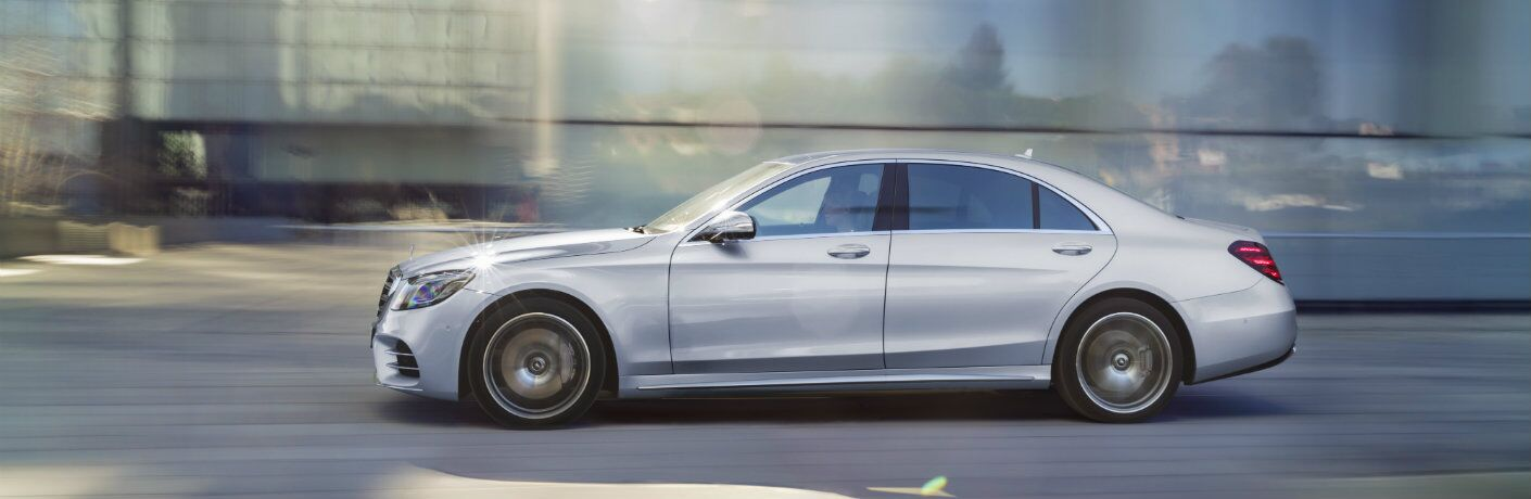 Gray Mercedes-Benz S-Class driving on the road