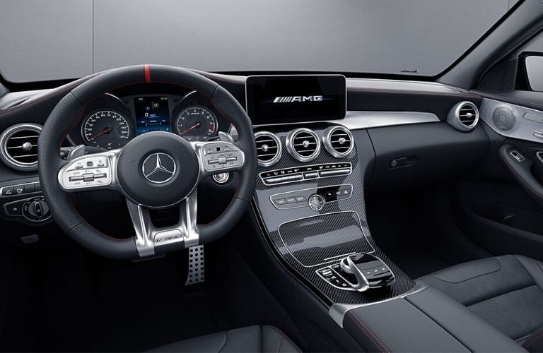 Interior view of the steering wheel and touchscreen inside a 2020 Mercedes-Benz AMG C 43