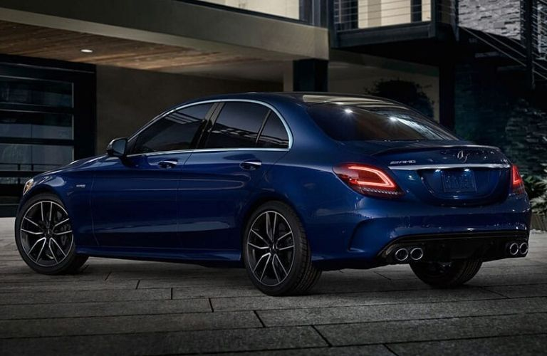 Exterior view of the rear of a blue 2020 Mercedes-Benz AMG C 43