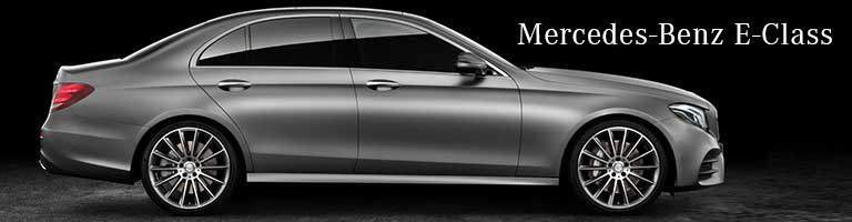 grey 2019 Mercedes-Benz E-Class with wording on right side
