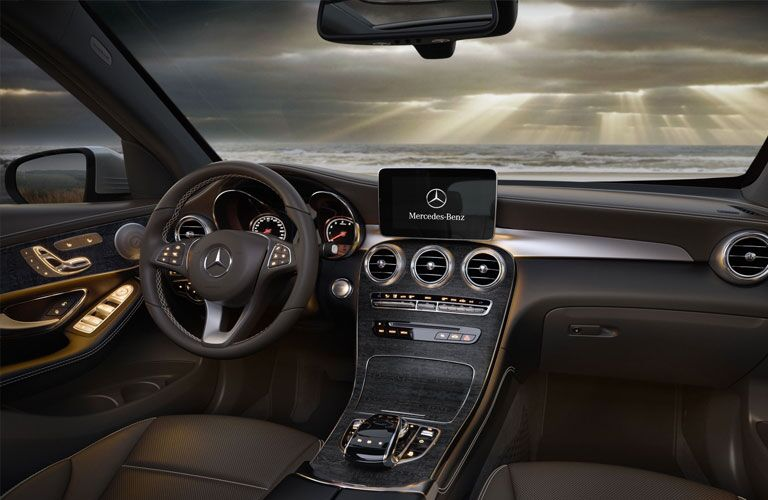 front interior of 2018 mercedes-benz glc 300 including steering wheel and infotainment system