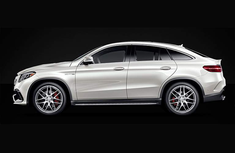 side view of a white 2018 Mercedes-Benz GLE on a black background