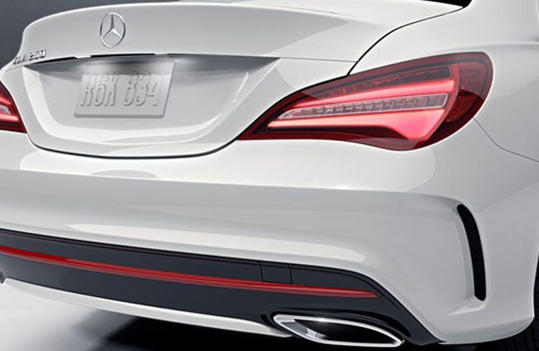 rear bumper and tail lights of white 2018 mercedes-benz cla 250