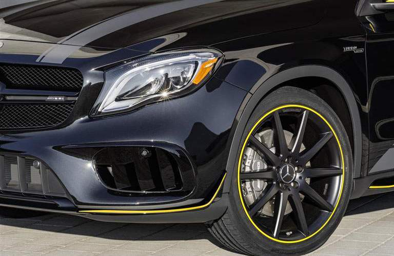 attractive front headlight and wheel of the 2018 Mercedes-Benz GLA AMG model
