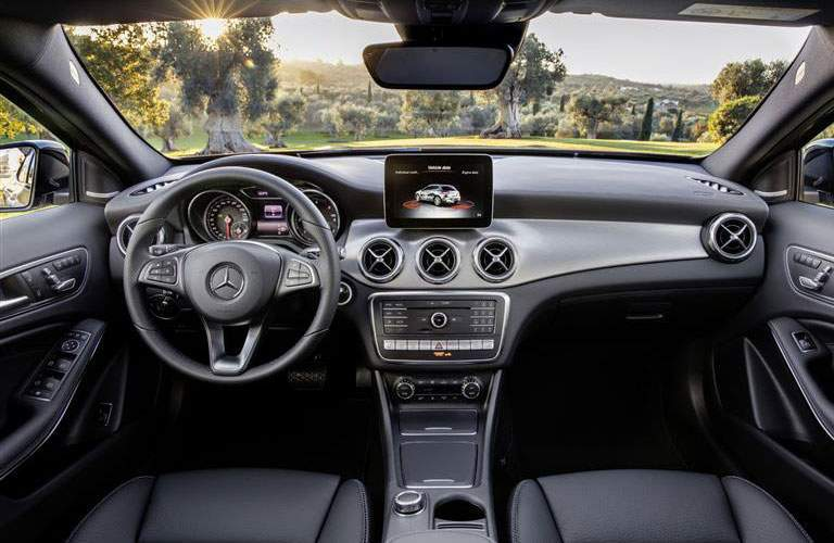 steering wheel, infotainment system, and windshield of the 2018 Mercedes-Benz GLA