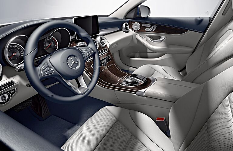 front interior of 2019 mercedes-benz c300 including steering wheel and infotainment system