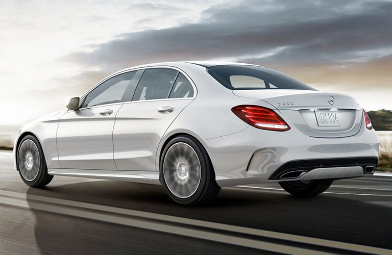 rear and side view of white 2019 mercedess-benz c300 sedan