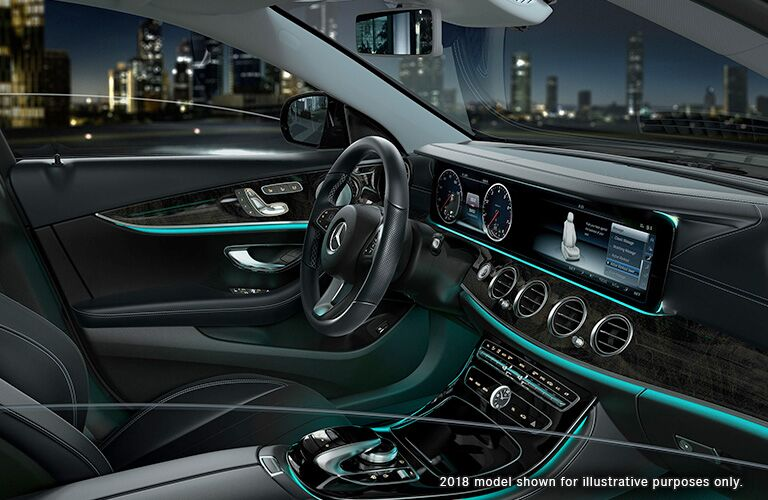 side view of front interior of 2019 mercedes-benz e300 sedan including steering wheel and center console