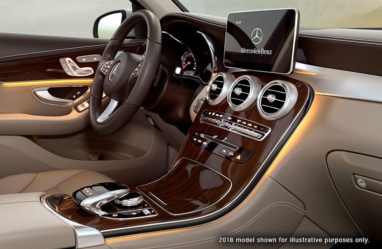 side view of front interior of 2019 mercedes-benz glc 300 including steering wheel and infotainment screen