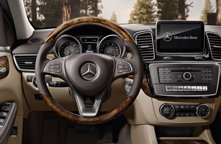 front interior of 2019 mercedes-benz gle 400 4matic suv including steering wheel and infotainment system