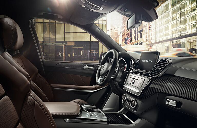 side view of front interior of 2019 mercedes-benz gls 450 including steering wheel and center console