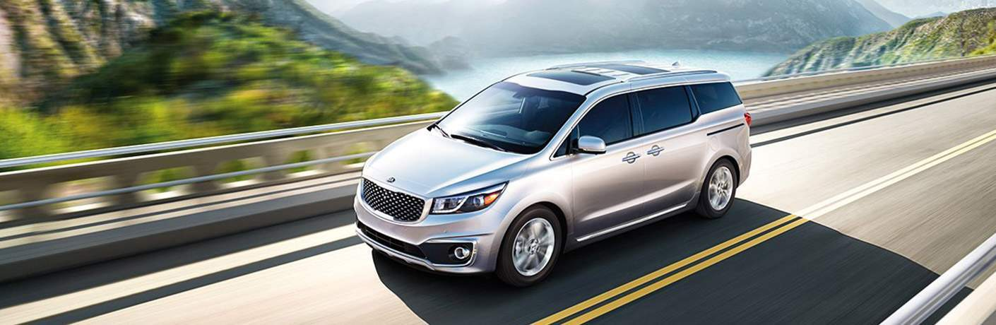 2018 Kia Sedona Traveling Down the Road in Silver Exterior Coloring