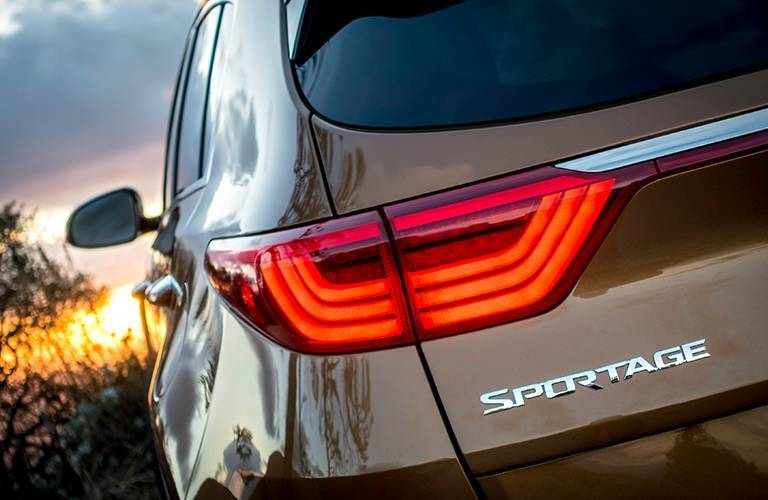 Sportage Emblem on Back of 2017 Kia Sportage in Tan