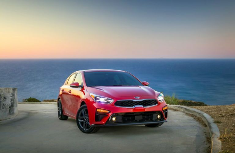2019 Kia Forte Front End View in Red Parked by Water