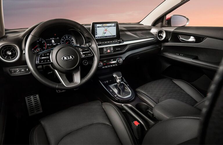 Interior cabin of the 2019 Kia Forte viewed from the driver's side.