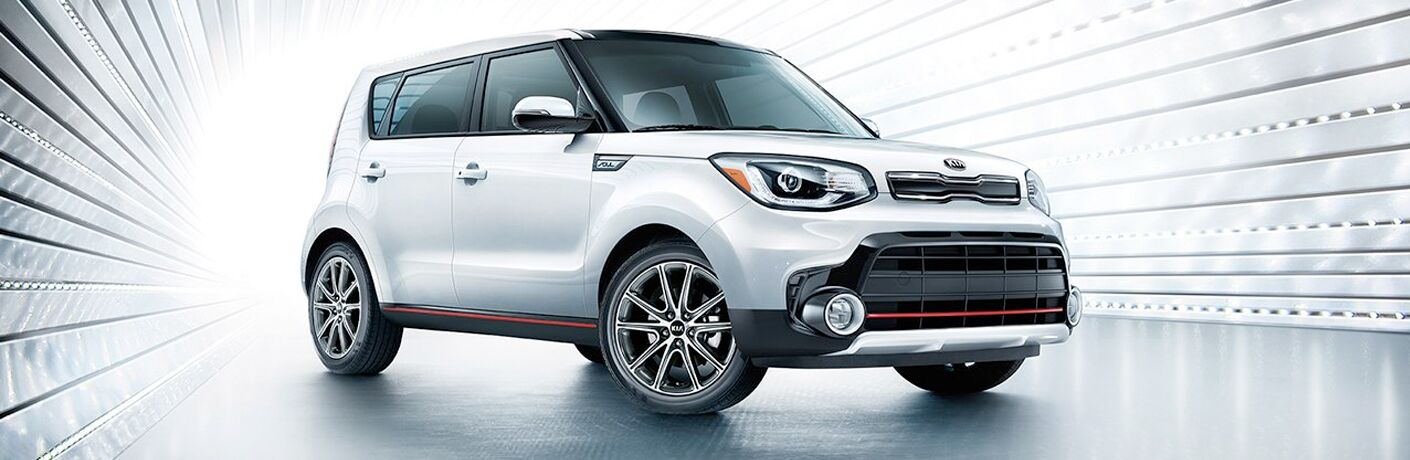 White 2019 Kia Soul parked in a futuristic white environment. Exterior side/front angled view.