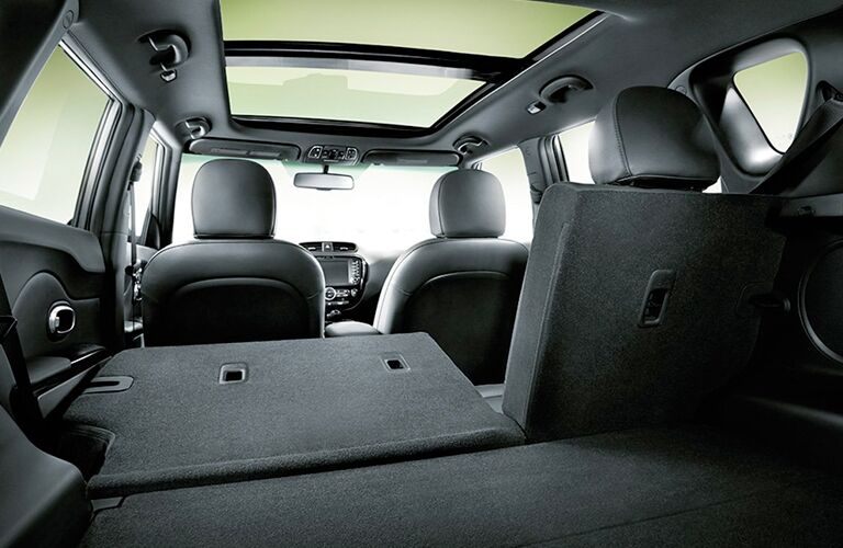 Interior rear cargo area of a 2019 Kia Sorento. Two rear seats are folded down, opening up more space.